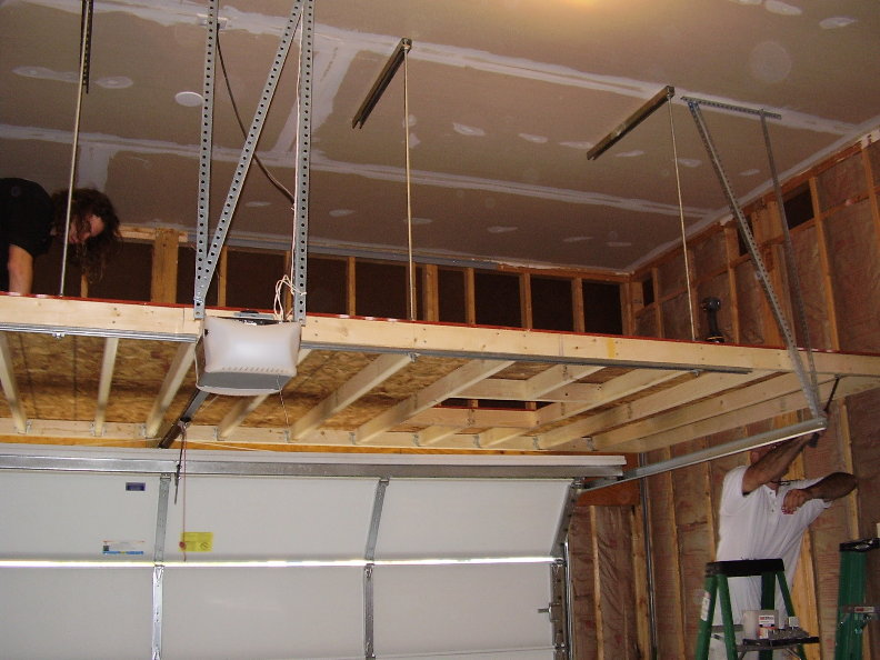 Build a mezzanine floor for storage in a garage joy for How to build a garage loft